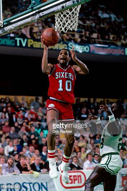 Maurice Cheeks of the Philadelphia 76ers shoots against the Boston Celtics during a game played circa 1983 at the Boston Garden in Boston...