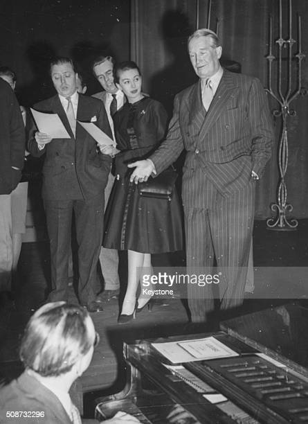 Maurice Chevalier singing his famous song 'Louise' accompanied by actors Janette Scott Ian Carmichael and Richard Attenborough at a rehearsal for the...