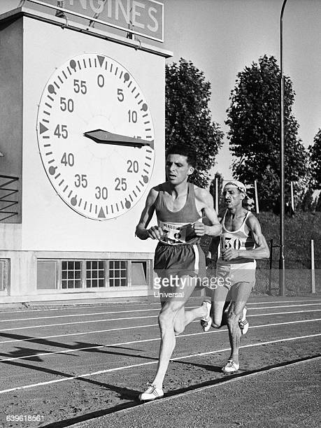 Maurice Chiclet and Alain Mimoun during the 10000meter run of the French Championships