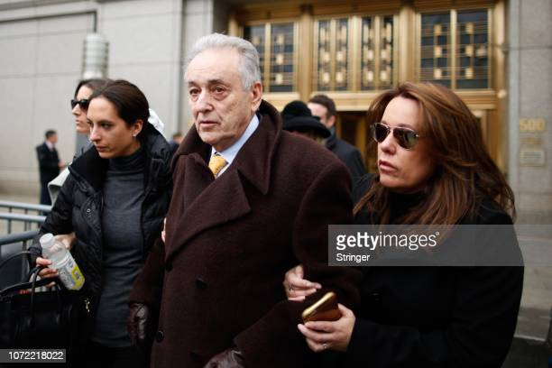 Maurice Cohen is helped by family members as he leaves after the sentencing of his son Michael Cohen President Donald Trump's former personal...
