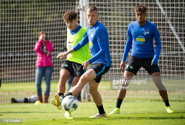 Maurice Covic passes the ball next to Marius Wolf and Sidney Friede of Hertha BSC during the training on september 10 2019 in Berlin Germany