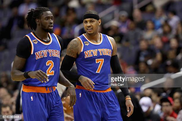 Maurice Daly Ndour of the New York Knicks and Carmelo Anthony talk during a timeout against the Washington Wizards at Verizon Center on November 17...