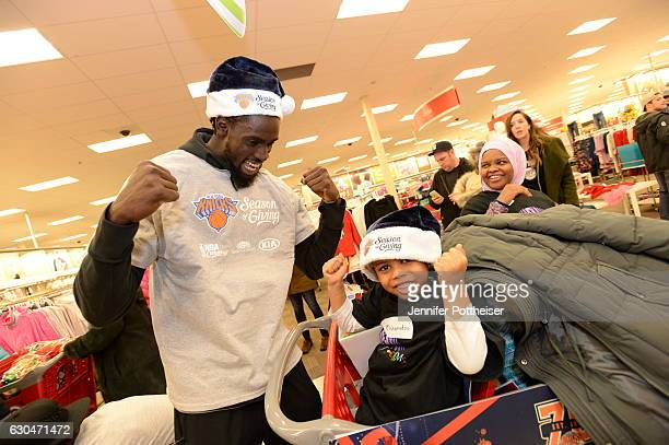 Maurice Daly Ndour of the New York Knicks and Garden of Dreams Season of Giving holiday team up for a shopping spree on December 21 2016 at Target in...