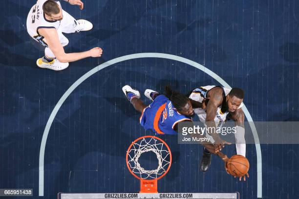 Maurice Daly Ndour of the New York Knicks and JaMychal Green of the Memphis Grizzlies fight for a rebound during a game on April 7 2017 at FedExForum...