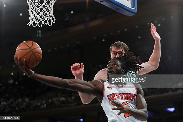 Maurice Daly Ndour of the New York Knicks puts up a layup defended by Tyler Zeller of the Boston Celtics during the first half of their preseason...