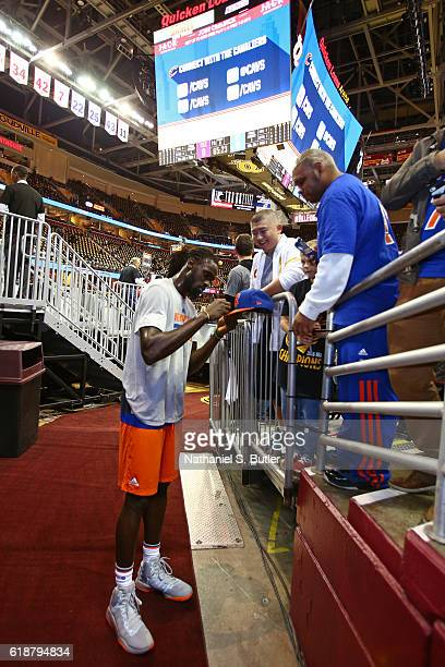 Maurice Daly Ndour of the New York Knicks signs autographs before the game against the Cleveland Cavaliers on October 25 2016 at Quicken Loans Arena...