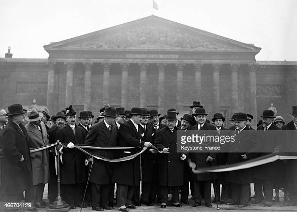 Maurice Deligne minister of public works cuting the ribbon at the inauguration of the Concorde bridge widening on December 22 1931 in Paris France