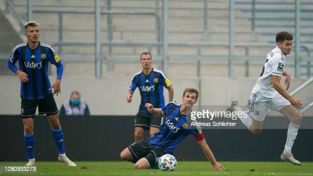 Maurice Deville and Manuel Zeitz of 1.FC Saarbruecken challenges Alexander Fuchs of Unterhaching during the 3. Liga match between 1. FC Saarbruecken...