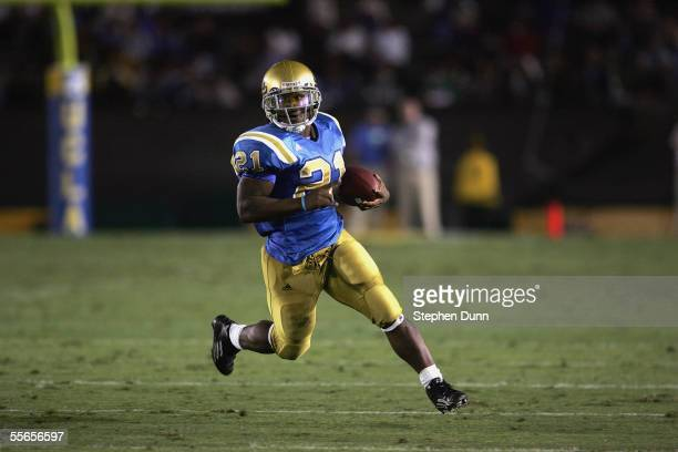 Maurice Drew of the UCLA Bruins gains the yardage against the Rice Owls on September 10 2005 at the Rose Bowl in Pasadena California UCLA won 6221
