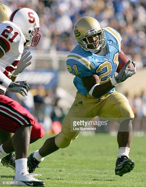 Maurice Drew of the UCLA Bruins tries to get past Oshiomogho Atogwe of the Stanford University Cardinal in the second half of the game on October 30...