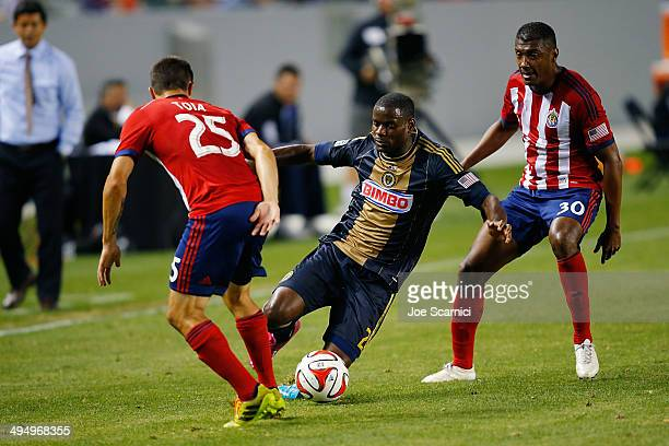Maurice Edu of Philadelphia Union defends the ball from Donny Toia and Oswaldo Minda of Chivas USA in the first half at StubHub Center on May 31 2014...