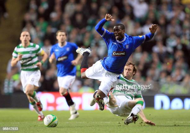 Maurice Edu of Rangers is tackled by Andreas Hinkel of Celtic during the Clydesdale Bank Scottish Premier League match between Celtic and Rangers at...