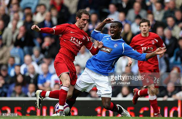 Maurice Edu of Rangers is tackled by Mark Kerr of Aberdeen during the Scottish Premier League match between Rangers and Aberdeen at Ibrox Stadium on...