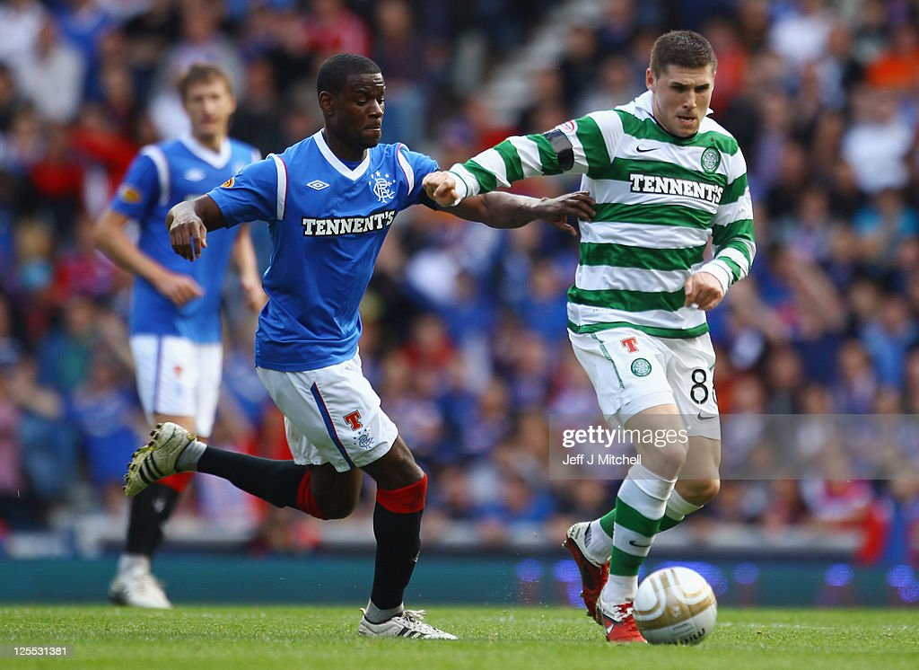 Maurice Edu of Rangers tackles Gary Hooper of Celtic during the Clydesdale Bank Premier League match between Rangers and Celtic at Ibrox Stadium on September 18, 2011 in Glasgow, Scotland.