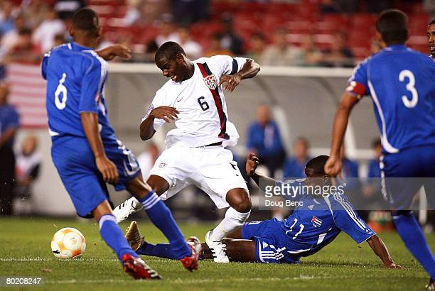 Maurice Edu of the United States is tackled by Enrique Villaurruta of Cuba during the CONCACAF U-23 Tournament - Olympic Qualifying at Raymond James...