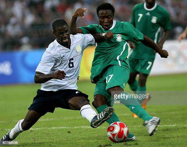 Maurice Edu of the US tries to block Emmanuel Ekpo of Nigeria during a 2008 Beijing Olympic Games first round group B men's football match at the...
