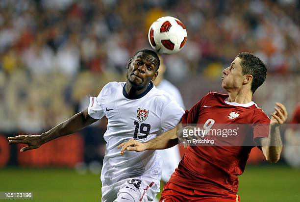Maurice Edu of the USA fights for the ball against Robert Lewandowski of Poland during the first half of their match on October 9 2010 at Soldier...