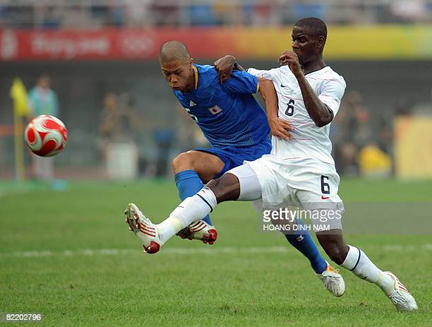 Maurice Edu of US vies for the ball with Japan's Takuya Honda during their 2008 Beijing Olympic Games first round group B Men's football match at the...