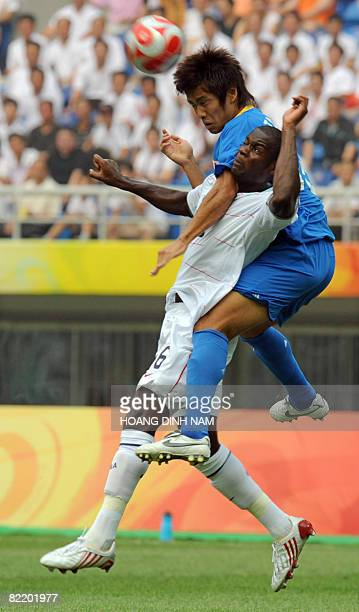 Maurice Edu of US vies with Japan's Yuto Nagatomo during their 2008 Beijing Olympic Games first round group B Men's football match at the Tianjin...