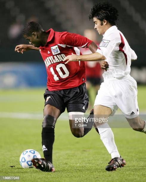 Maurice Edu#10 holds of Josh Tudela during the NCAA Men's Soccer College Cup Semi Final Home Depot Center Carson California December 10 2004 U of...