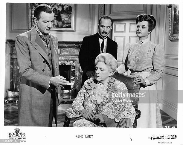 Maurice Evans handing note to Ethel Barrymore as Keenan Wynn and Angela Lansbury watch in a scene from the film 'Kind Lady' 1951