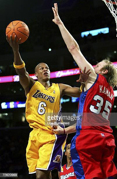 Maurice Evans of the Los Angeles Lakers lays the ball up against Chris Kaman of the Los Angeles Clippers November 21 2006 at Staples Center in Los...