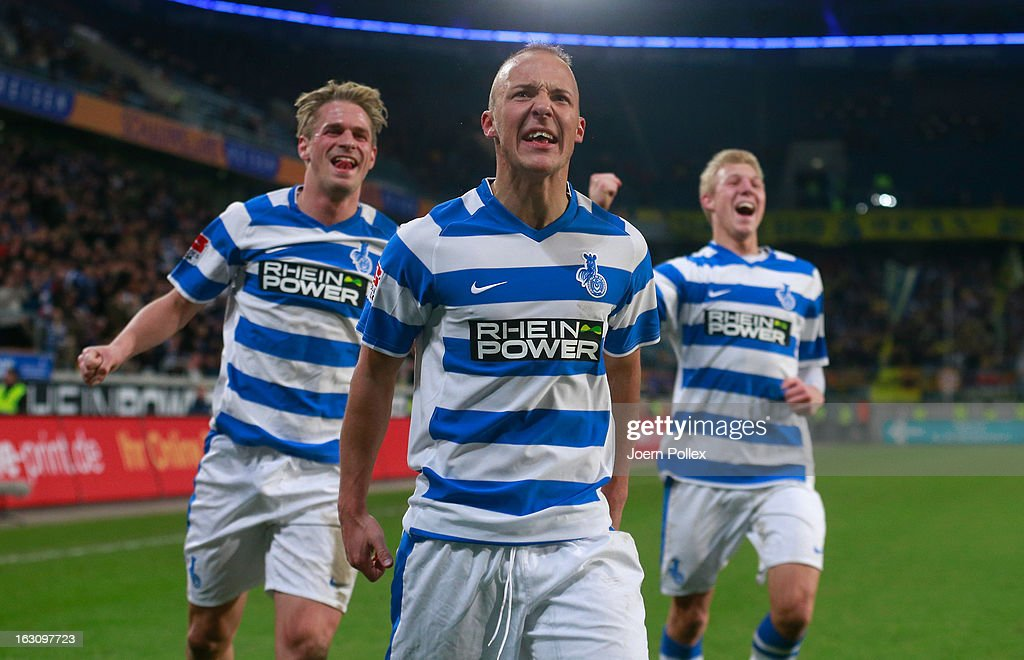 Maurice Exslager (C) of Duisburg celebrates after scoring his team's first goal during the Second Bundesliga match between MSV Duisburg and Eintracht Braunschweig at Schauinsland-Reisen-Arena on March 4, 2013 in Duisburg, Germany.