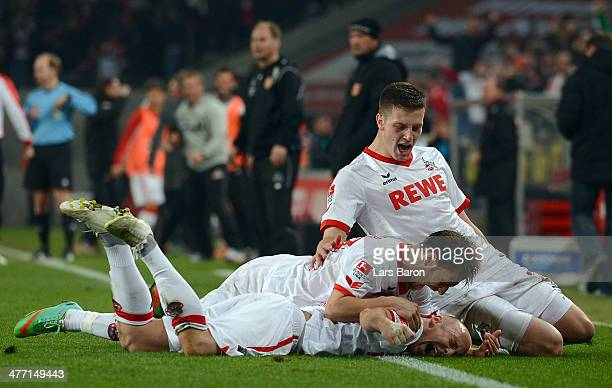 Maurice Exslager of Koeln celebrates after scoring his teams second goal during the Second Bundesliga match between 1. FC Koeln and Energie Cottbus...