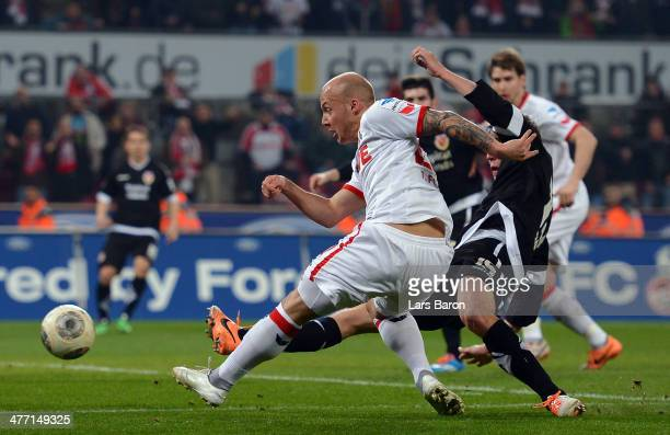 Maurice Exslager of Koeln scores his teams second goal during the Second Bundesliga match between 1. FC Koeln and Energie Cottbus at...