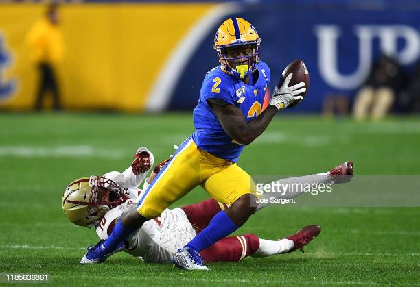 Maurice Ffrench of the Pittsburgh Panthers avoids a tackle by John Phillips of the Boston College Eagles during the third quarter at Heinz Field on...