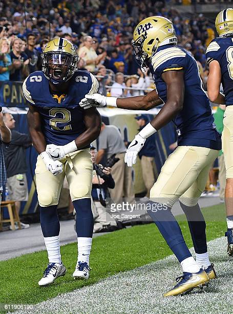 Maurice Ffrench of the Pittsburgh Panthers celebrates his touchdown with Aaron Mathews during the first quarter against the Marshall Thundering Herd...