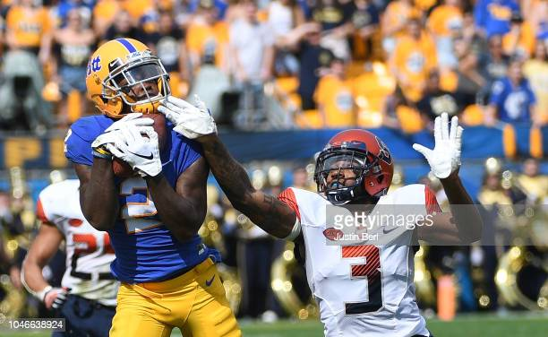 Maurice Ffrench of the Pittsburgh Panthers makes a catch as Christopher Fredrick of the Syracuse Orange defends in the second quarter during the game...
