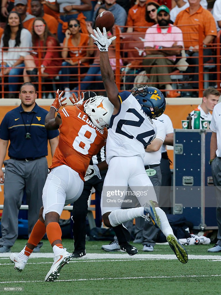 Maurice Fleming #24 of the West Virginia Mountaineers tips the ball away from Dorian Leonard #8 of the Texas Longhorns at Darrell K Royal -Texas Memorial Stadium on November 12, 2016 in Austin. Texas.