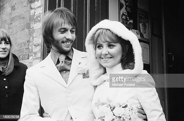 Maurice Gibb of the Bee Gees and his wife Lulu leaving St James's Church after their wedding in Gerrards Cross Buckinghamshire 18th February 1969
