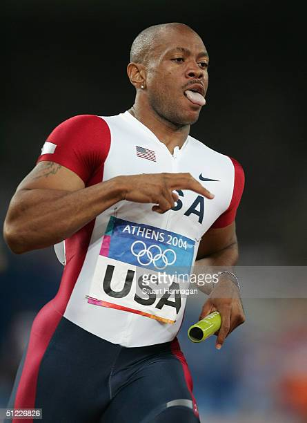 Maurice Green of USA competes during the men's 4 x 100 metre relay on August 27 2004 during the Athens 2004 Summer Olympic Games at the Olympic...