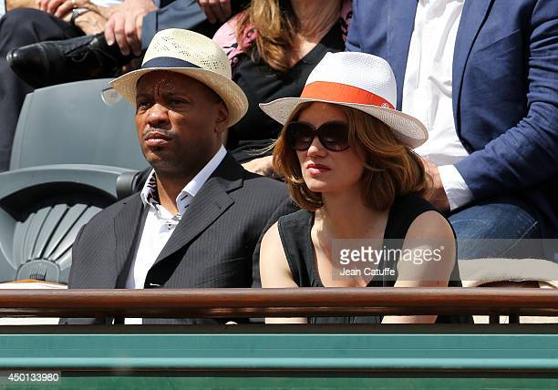 Maurice Greene and Marine Delterme attend Day 12 of the French Open 2014 held at Roland-Garros stadium on June 5, 2014 in Paris, France.