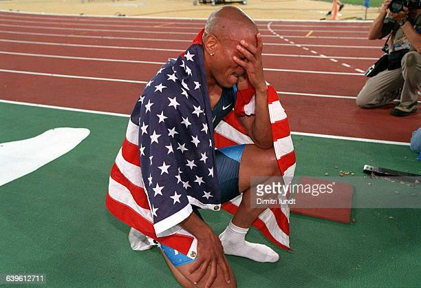 Maurice Greene kneels on the track after winning the men's 100 metres final at the Sydney 2000 Olympic Games