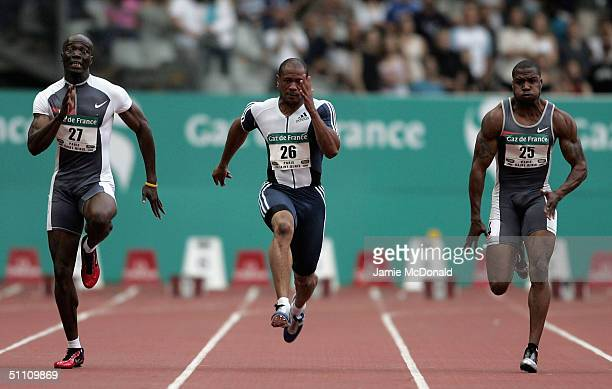 Maurice Greene of USA loses to Francis Obikwelu of Portugal during the mens 100m event at the IAAF Golden League meet at the Stade de France on July...