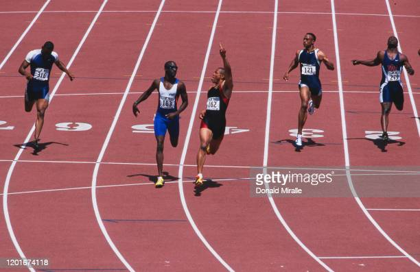 Maurice Greene raises his finger and pokes his tongue out toward second placed Rohsaan Griffin after winning the Men's 200 metre final event at the...