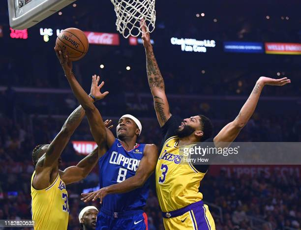 Maurice Harkless of the LA Clippers attempts a layup between Anthony Davis and Dwight Howard of the Los Angeles Lakers during a 112102 Clipper win in...