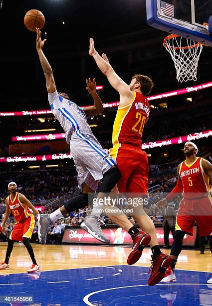 Maurice Harkless of the Orlando Magic attempts a shot over Donatas Motiejunas of the Houston Rockets during the game at Amway Center on January 14...