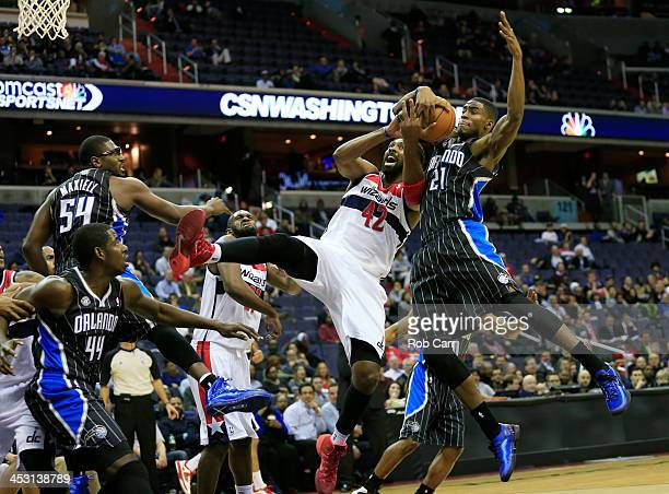 Maurice Harkless of the Orlando Magic blocks a shot by Nene Hilario of the Washington Wizards during the first half at Verizon Center on December 2...