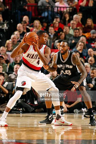 Maurice Harkless of the Portland Trail Blazers defends the ball against Rasual Butler of the San Antonio Spurs during the game on November 11 2015 at...