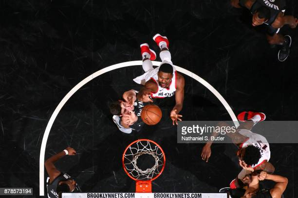 Maurice Harkless of the Portland Trail Blazers dunks against Joe Harris of the Brooklyn Nets on November 24 2017 at Barclays Center in Brooklyn New...