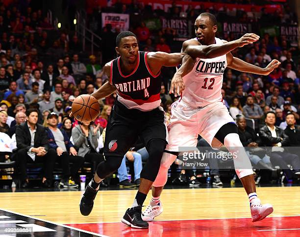 Maurice Harkless of the Portland Trail Blazers goes baseline on Luc Richard Mbah a Moute of the Los Angeles Clippers during the first half at Staples...