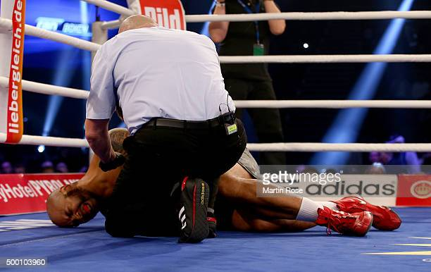 Maurice Harris of USA lies on the floor during their heavyweight fight at Inselparkhalle on December 5 2015 in Hamburg Germany