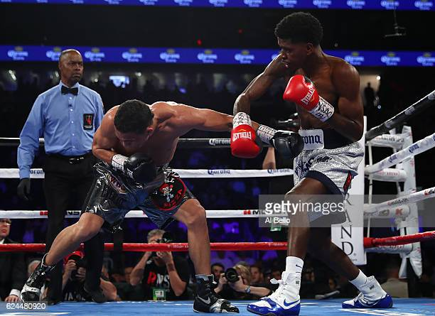 Maurice Hooker and Darleys Perez of Colombia trade punches during their junior welterweights bout at TMobile Arena on November 19 2016 in Las Vegas...