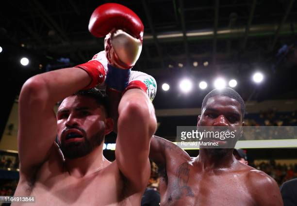 Maurice Hooker and Jose Ramirez during their WBO & WBC Junior Welterweight World Championship fight at College Park Center on July 27, 2019 in...