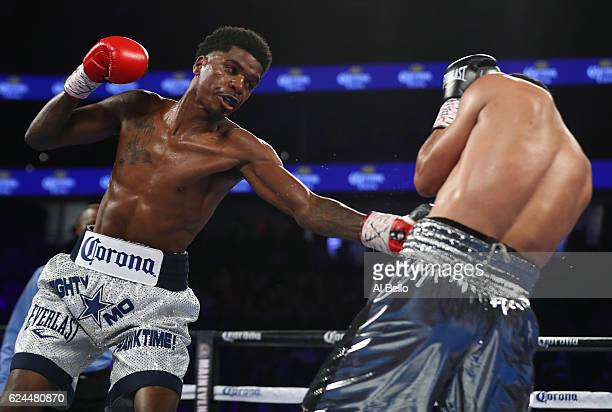 Maurice Hooker delivers a left to the body of Darleys Perez of Colombia during their junior welterweights bout at TMobile Arena on November 19 2016...