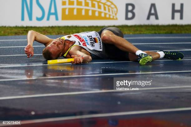 Maurice Huke of Germany lays on the track after falling during the first heat of the Men's 4x200 Metres Relay during the IAAF/BTC World Relays...